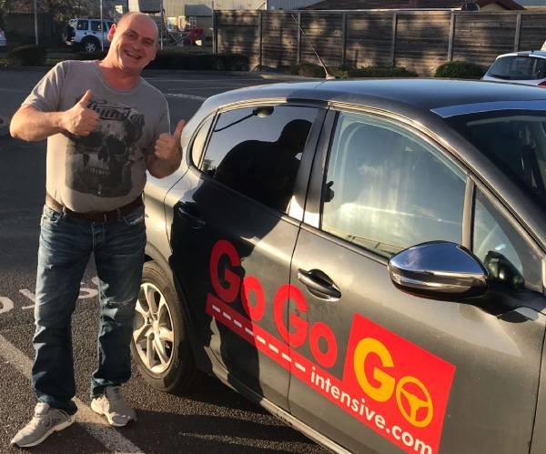 Martin Hicks sticking two thumbs up after passing his practical test